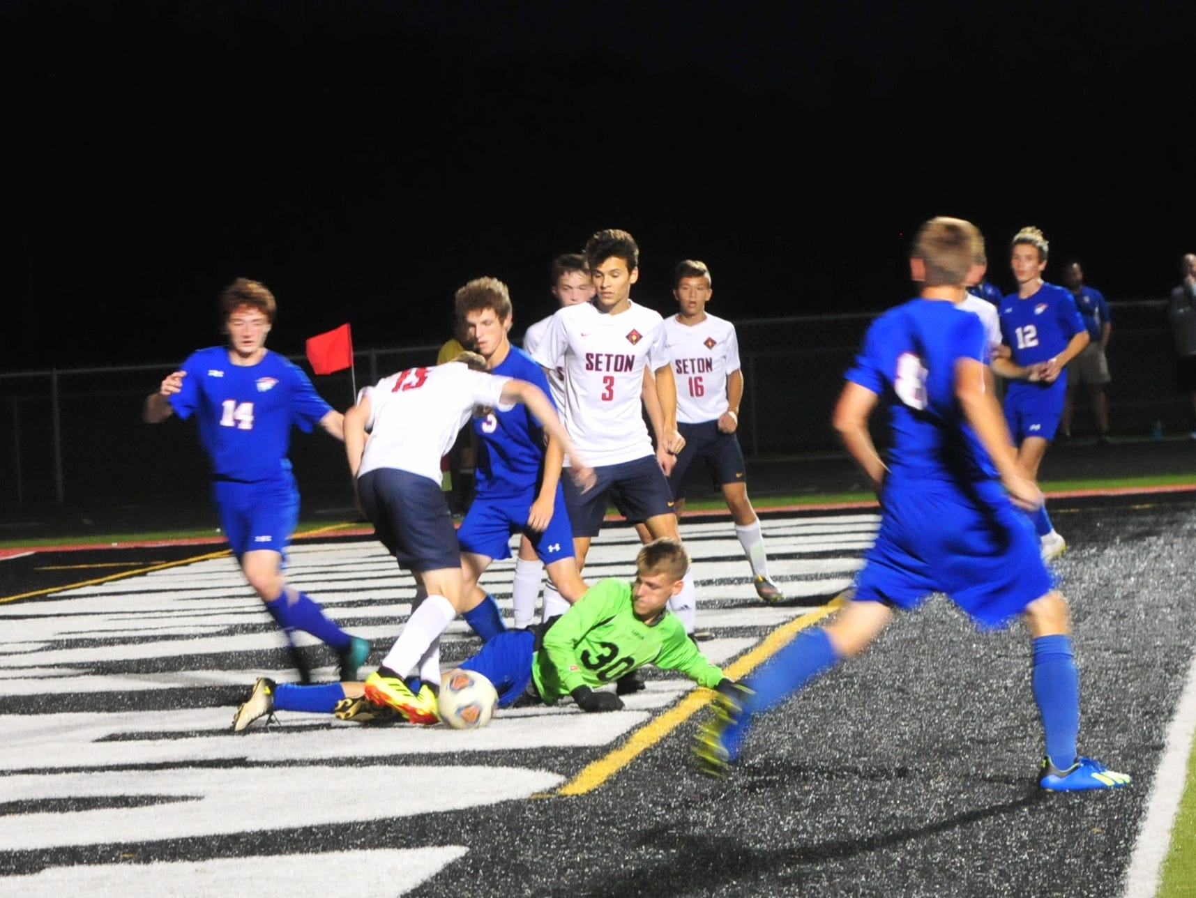 Union County's goalkeeper tries to save the ball during the IHSAA Class A Sectional 42 boys soccer semifinal at Knightstown Wednesday, Oct. 3, 2018.