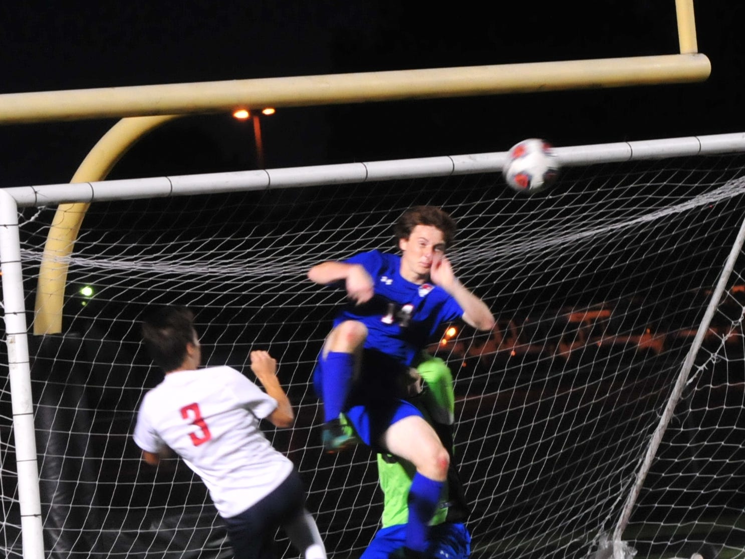 Union County's Dylan Dunaway (14) leaps to save a ball during the IHSAA Class A Sectional 42 boys soccer semifinal against Union County at Knightstown Wednesday, Oct. 3, 2018.