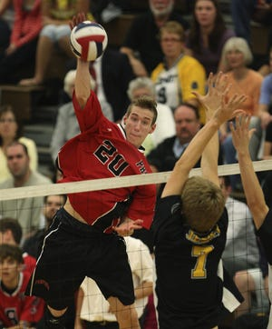 Penfield's Matt Sutherland (20) tries to spike the ball past McQuaid's Taylor Schumacher (7) in the 2008 Class A final.