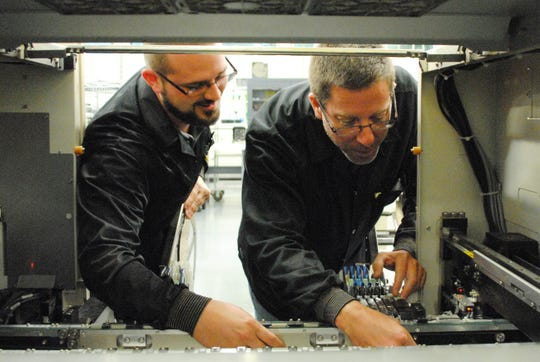 Process Engineers Mike Balch and Dan Basch at work at Surmotech.