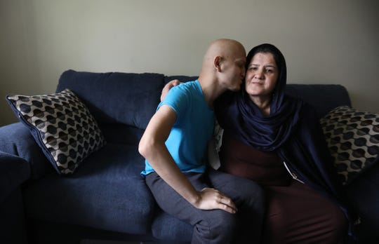 Burhanuddin (Burhan) Shamsuddin gives his mother, Madina Bikzad, a kiss.  He hasn't seen his mother in five years.  He has spent those years seeking treatment for his cancer.   She arrived from Afghanistan Tuesday, Oct. 2, 2018 to be with her son for three months.   He has an incurable cancer and he kept telling his doctors he wanted his mother with him and after about a year of trying to get her a visa to visit they got all the papers needed for her to come.