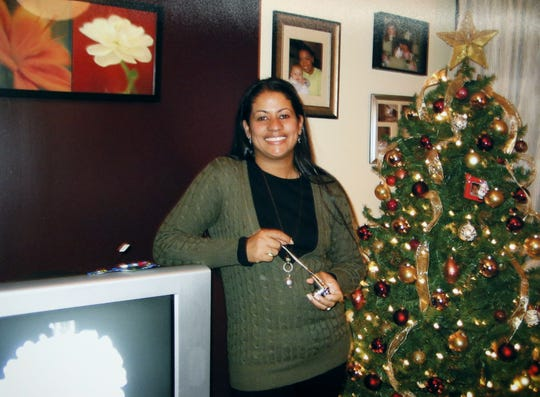 Photo of Sandy Guardiola (provided by the family) during a press conference at the Holiday Inn Express in Canandaigua. The family of parole officer Sandy Guardiola, who was shot and killed by Canandaigua police officer Scott Kadien while in her bed a year ago, have filed a civil rights lawsuit.