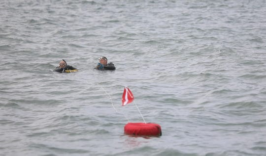 Rochester Police Scuba Team use the fast current at Fort Niagara to train.