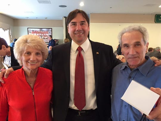 Mark Assini, center, with Nellie and Quintino DiCesare