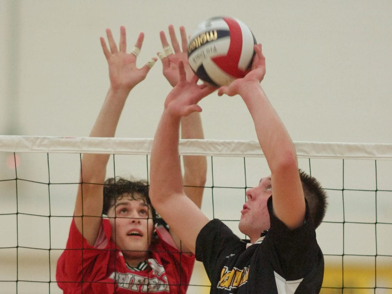 Penfield's Nick Witorski, left, goes up with McQuaid's Kyle Prem (12) in the 2006 volleyball final.