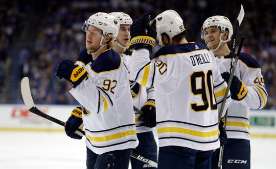 Buffalo Sabres right wing Alexander Nylander (92) celebrates with teammates, including Ryan O'Reilly (90) and Brendan Guhle (45), after scoring against the Tampa Bay Lightning during the first period of an NHL hockey game Friday, April 6, 2018, in Tampa, Fla.