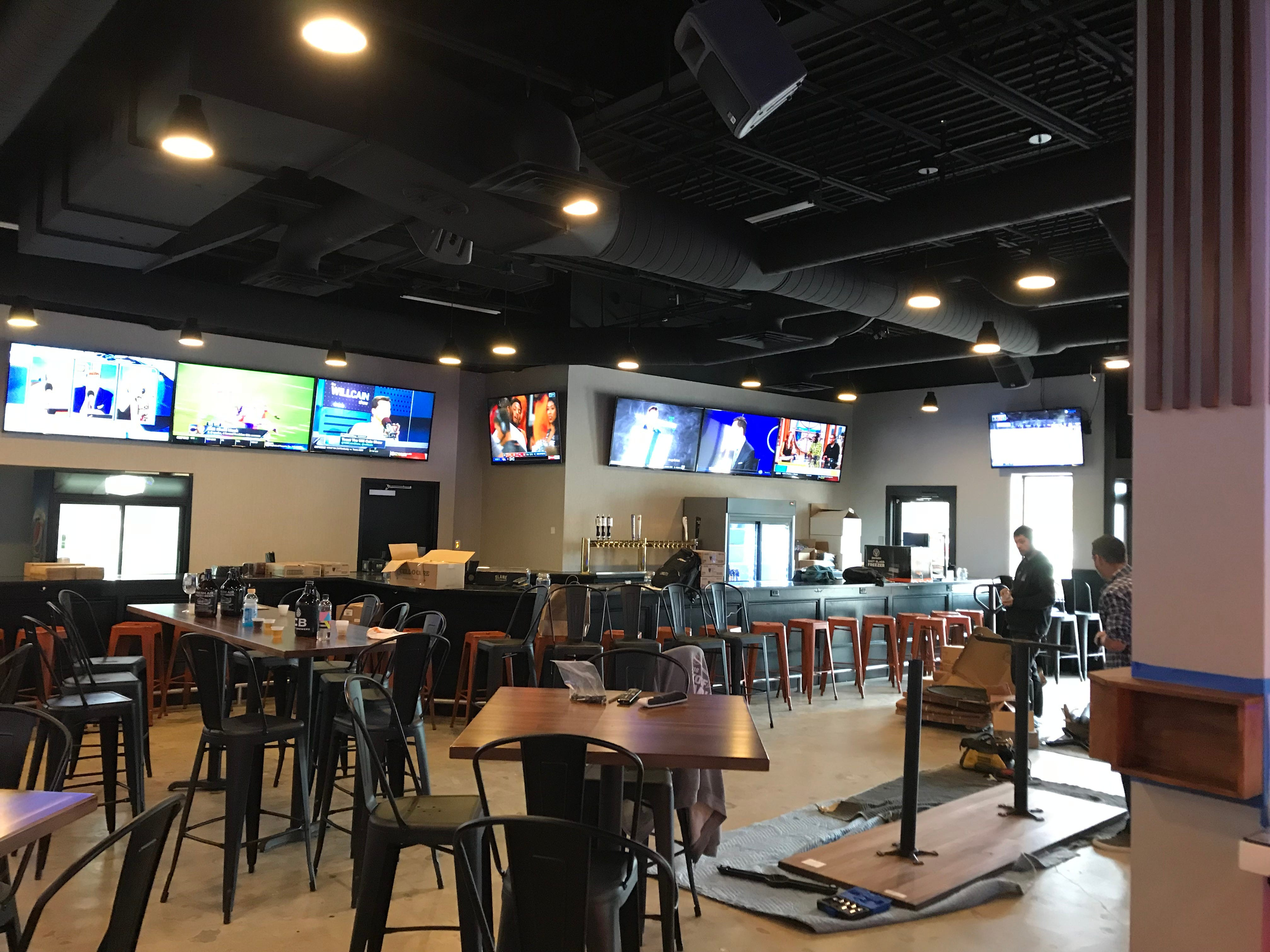 The spacious dining room and bar at Malt + Ember at The Mall at Greece Ridge.