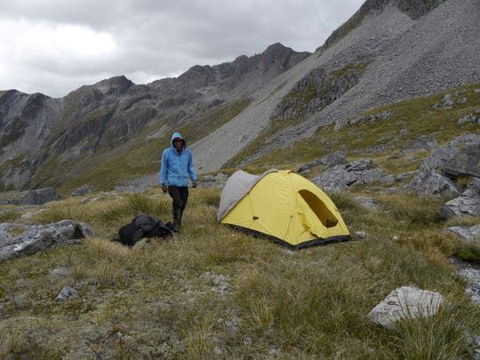 J. R. Harris at his campsite in the Canadian Rockies.