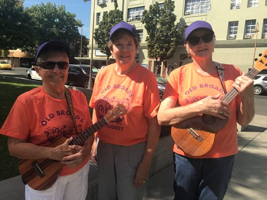 """From left, """"Old Broads for Audrey"""" members Melinda Self, 73, Janet Rauch, 75, and Sara Simmons, 67, hold the ukuleles they use to sing classic songs they rewrote in support of California district 1 congressional hopeful Audrey Denney on September 28 in Chico."""