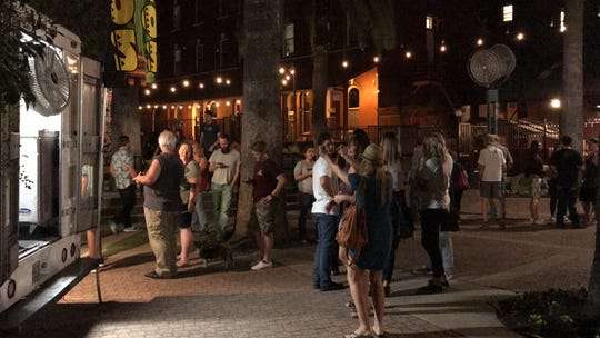 Food truck customers congregate the night of Sept. 27 when The Park held its grand opening in downtown Redding.