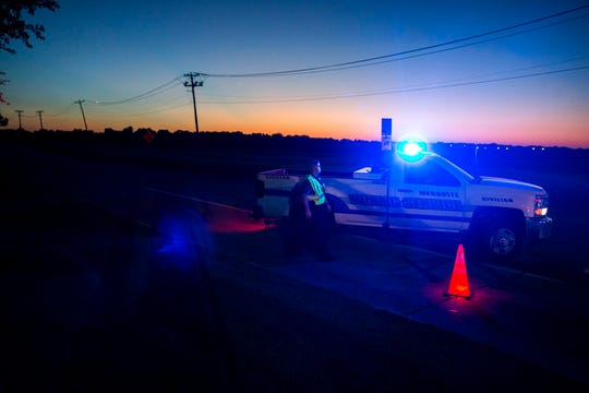 Officials block roads where one student died when a Mesquite Independent School District bus rolled into a ditch with 42 students on board in Mesquite, Texas on Wednesday, Oct. 3, 2018.