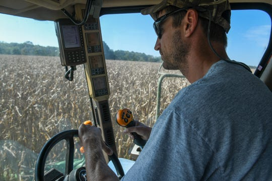 Fourth generation farmer John Bruning harvests corn in Snow Hill on Wednesday, Oct 4, 2018.
