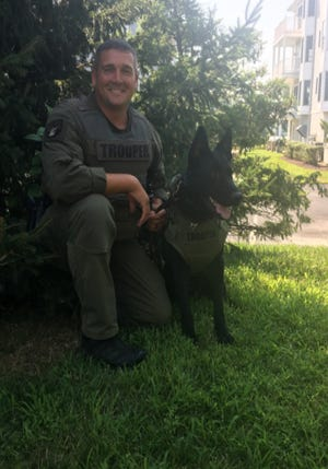 K-9 Plank, a German shepherd, is paired with Cpl. Dana Orndorff and was named in honor of Trooper First Class Edward Plank who was shot and killed by a suspect during an October 1995 traffic stop.