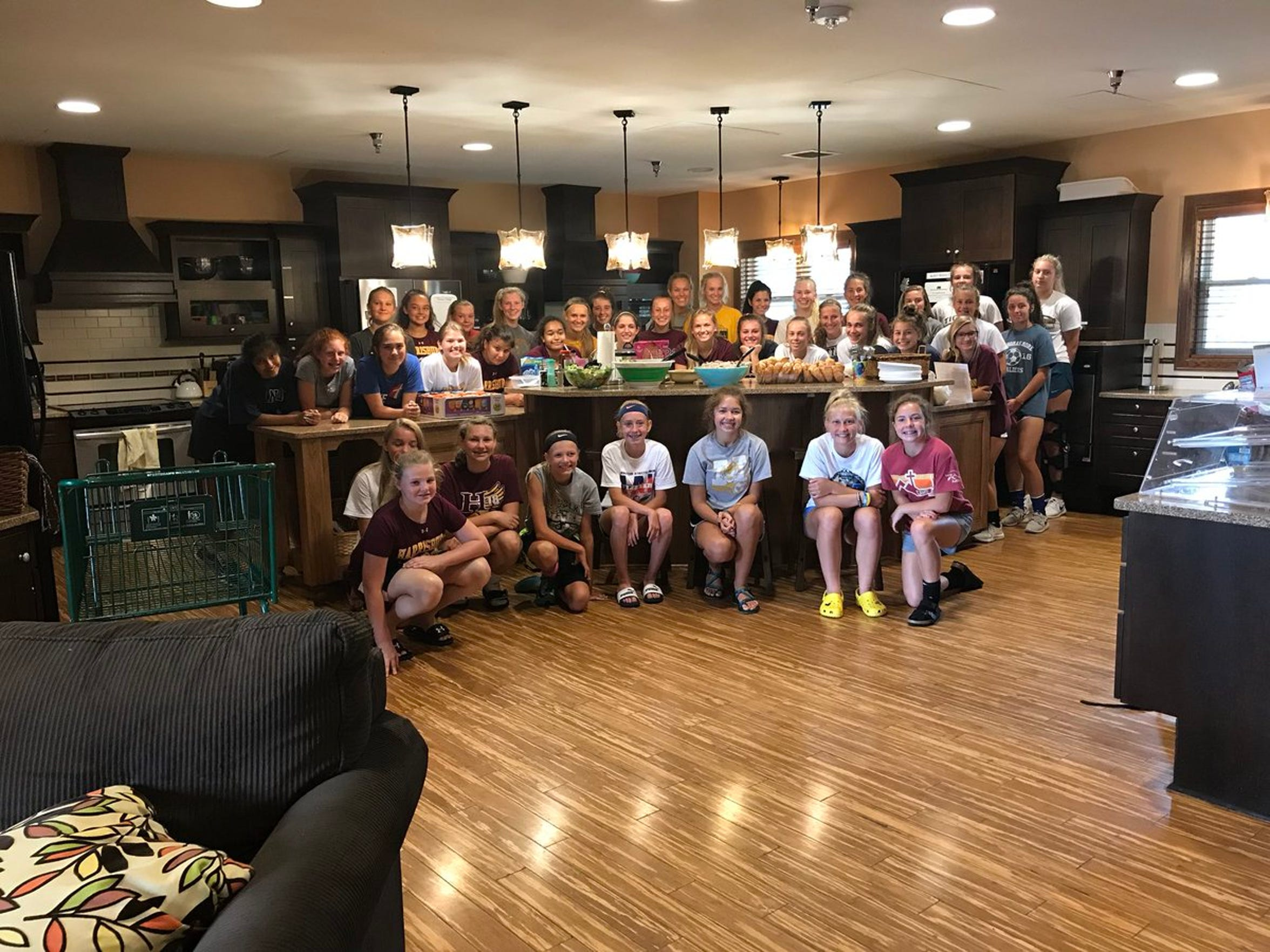 Members of the Harrisburg girls soccer team pose for a photo inside the Ronald McDonald House.