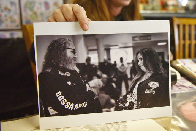 Amy Little shows a photo from her wedding of her and her late husband Jody Little Tuesday, Oct. 2, at Outlaw Tattoo in Sioux Falls. Little was killed after his motorcycle went off the road as he tried to slow down to avoid a deer crossing 60th Street North near Kiwanis Avenue.