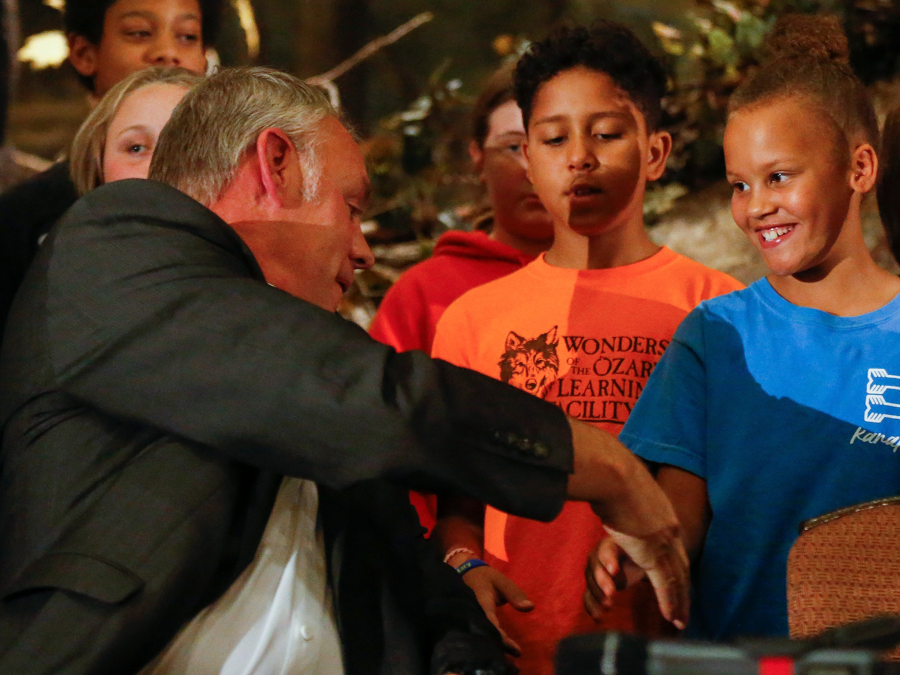 U.S. Secretary of the Interior Ryan Zinke shakes hands with students from the WOLF School before signing a proclamation during the 11th Annual Private Lands Partners Day at the White River Conference Center on Thursday, Oct. 4, 2018.