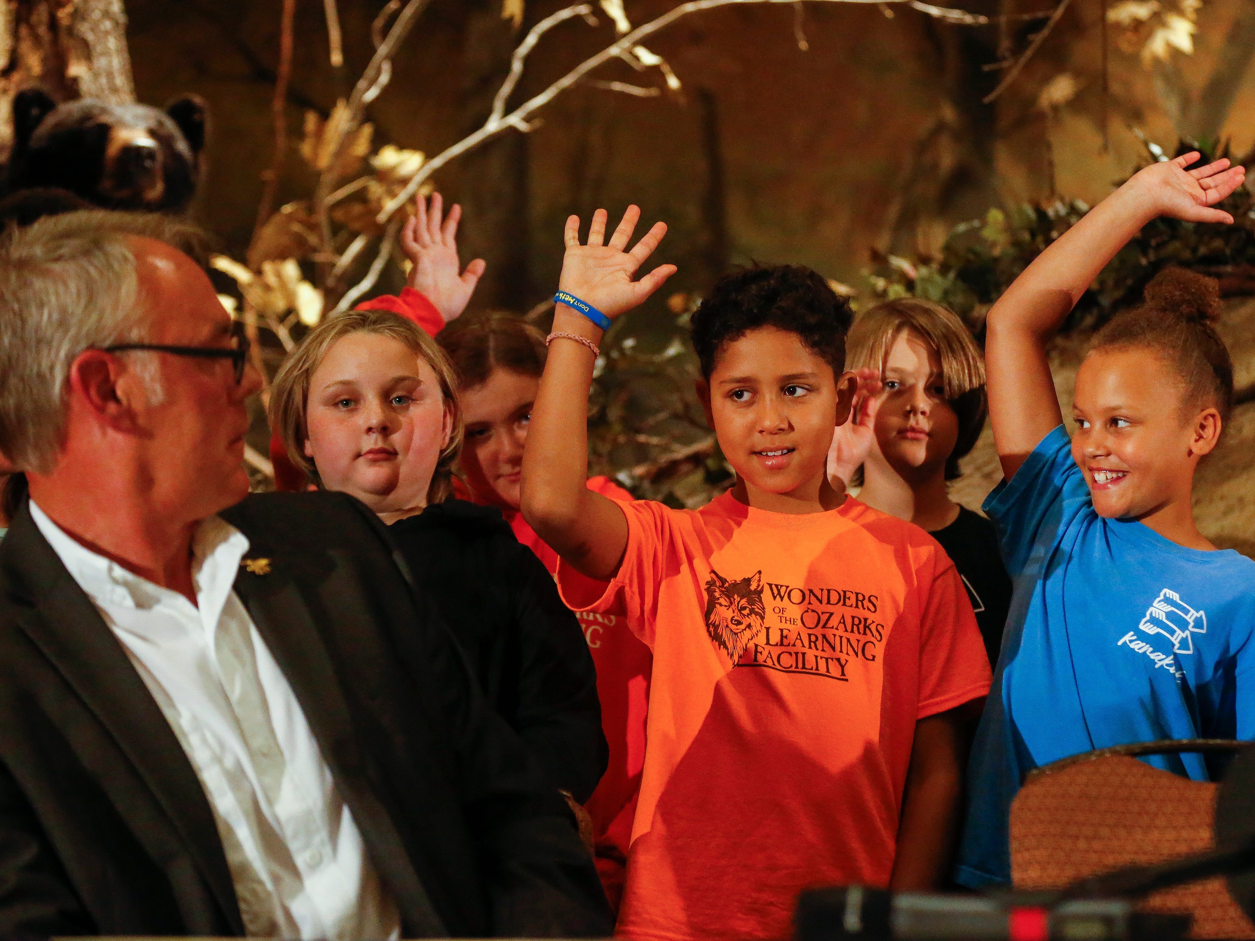 U.S. Secretary of the Interior Ryan Zinke looks at all the students from the WOLF School who raised their hands when he asked how many of them had been fishing during the 11th Annual Private Lands Partners Day at the White River Conference Center on Thursday, Oct. 4, 2018.