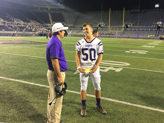 Waynesboro's Devon Owens talks to his coach after a game that left him with a concussion, played at James Madison University on Sept. 29, 2018.