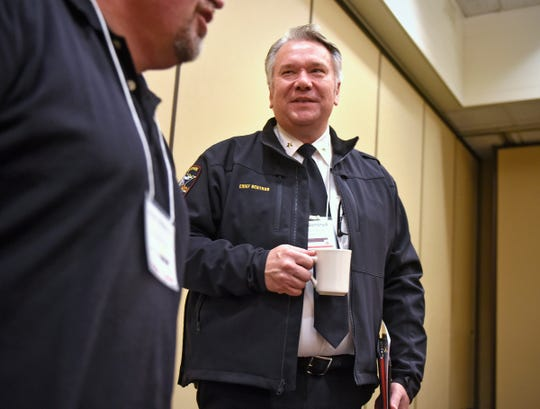 Waite Park Police Chief Dave Bentrud speaks with people after appearing on a panel during a conference Thursday, Oct. 4, in St. Cloud.