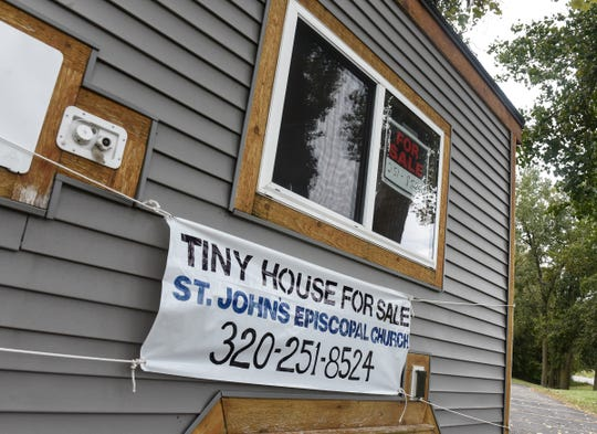 """A """"tiny house"""" is for sale in front of St. John's Episcopal Church in St. Cloud."""