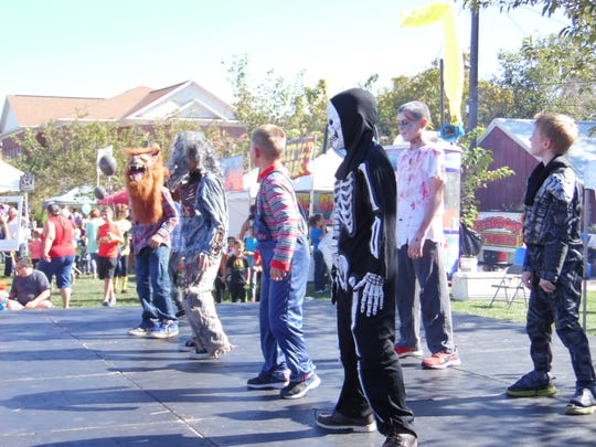 Kids in costumes attend the Spookytown Fair in St. George.