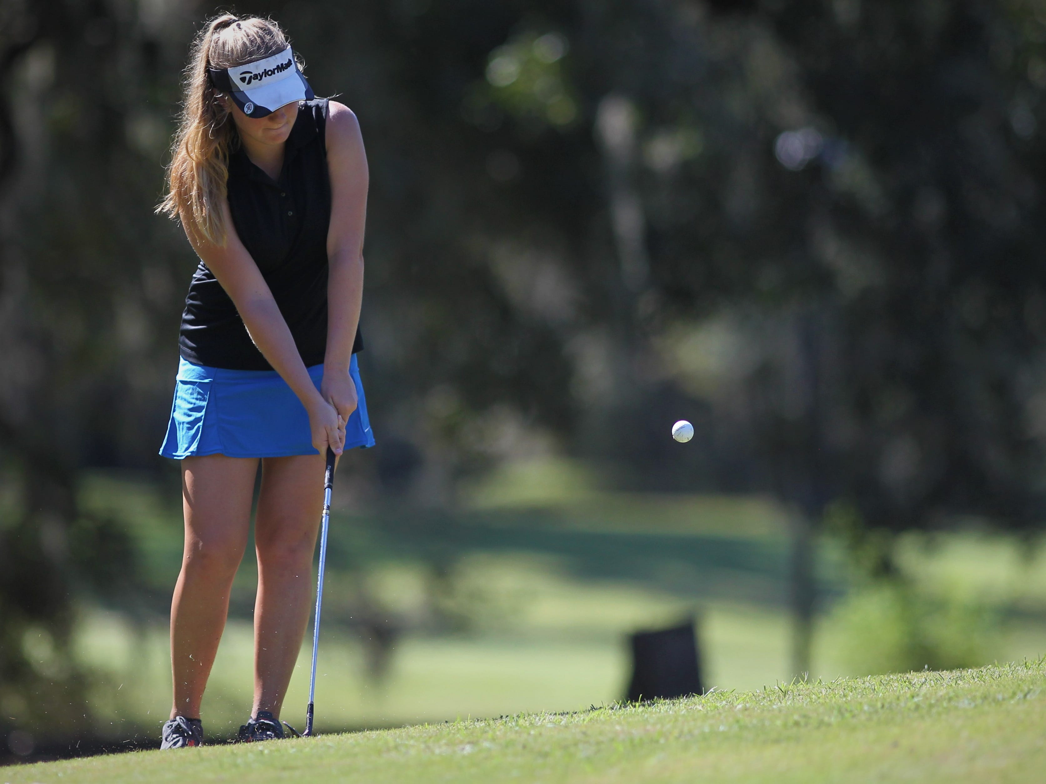 Franklin County senior Melanie Collins chips onto the green during the girls golf Panhandle Invitational at Killearn Country Club, Oct. 4, 2018.