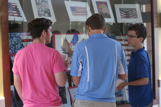Maclay high school students marvel at their peers' work on display at the Tallahassee National Cemetery on October  4, 2018.