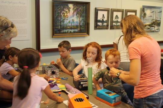 Children work at the Second Saturday program at the Museum of Florida.