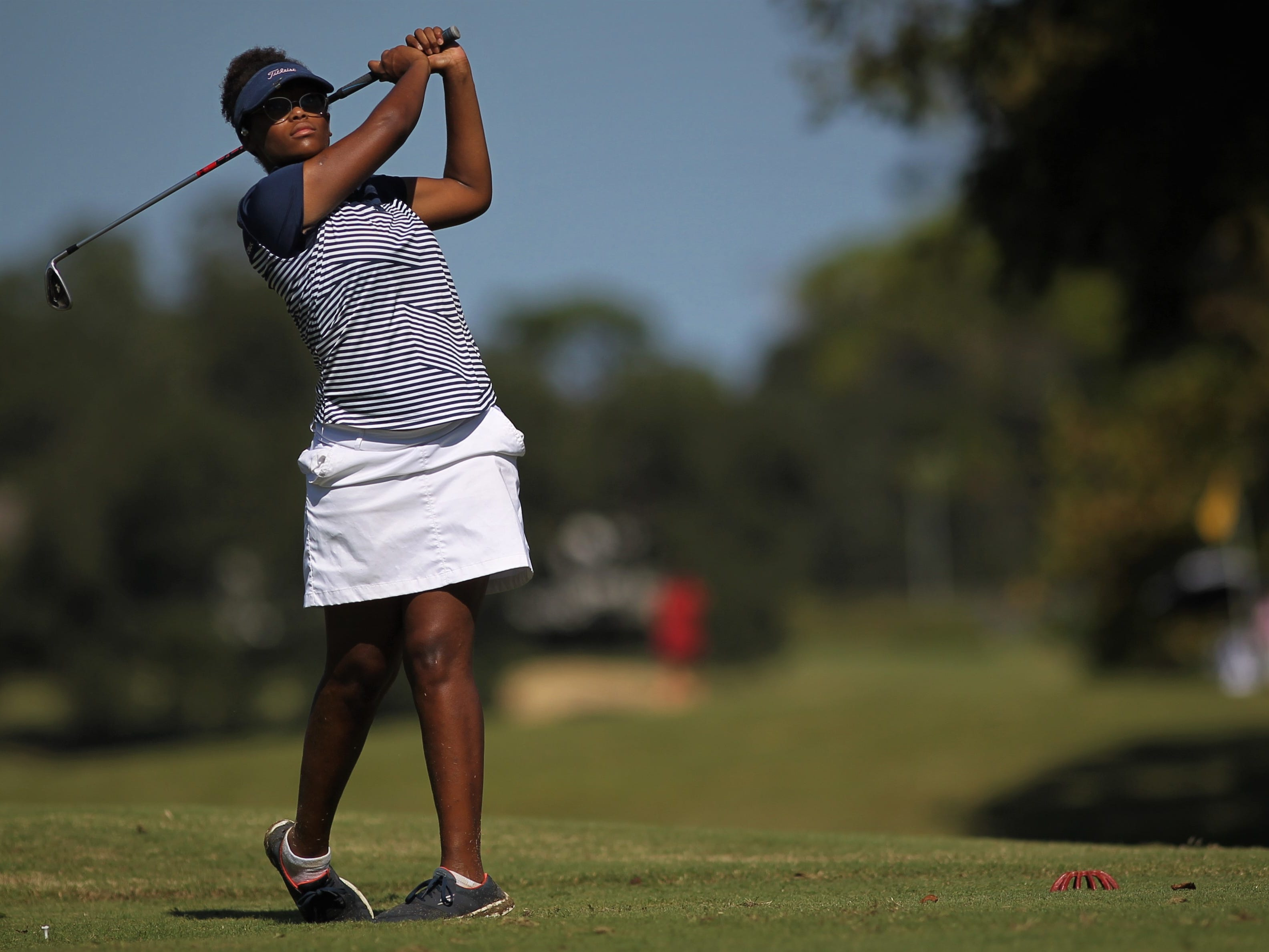 Maclay sophomore Annika Dean watches a tee shot during the girls golf Panhandle Invitational at Killearn Country Club, Oct. 4, 2018.