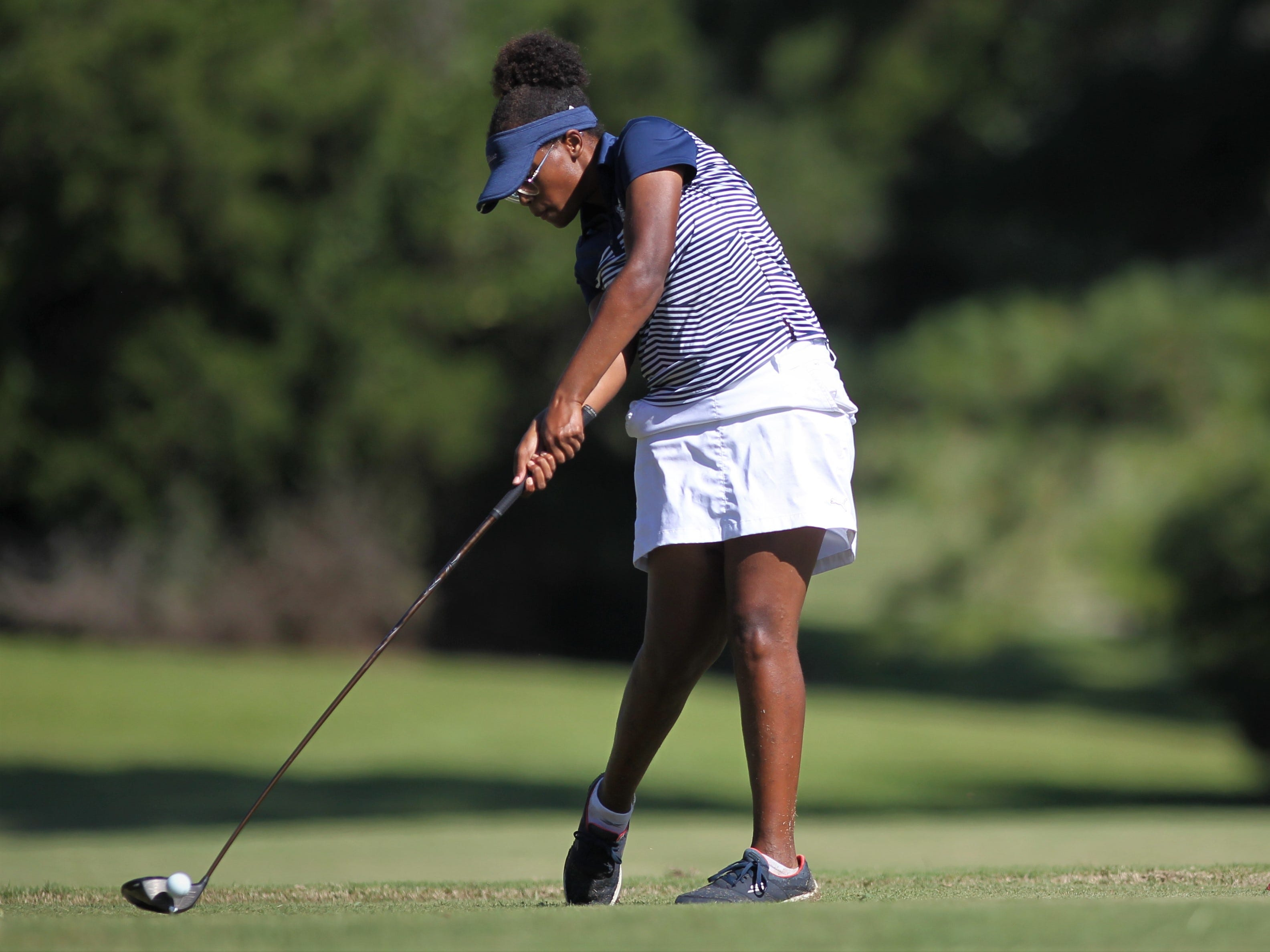 Maclay sophomore Annika Dean tees off during the girls golf Panhandle Invitational at Killearn Country Club, Oct. 4, 2018.