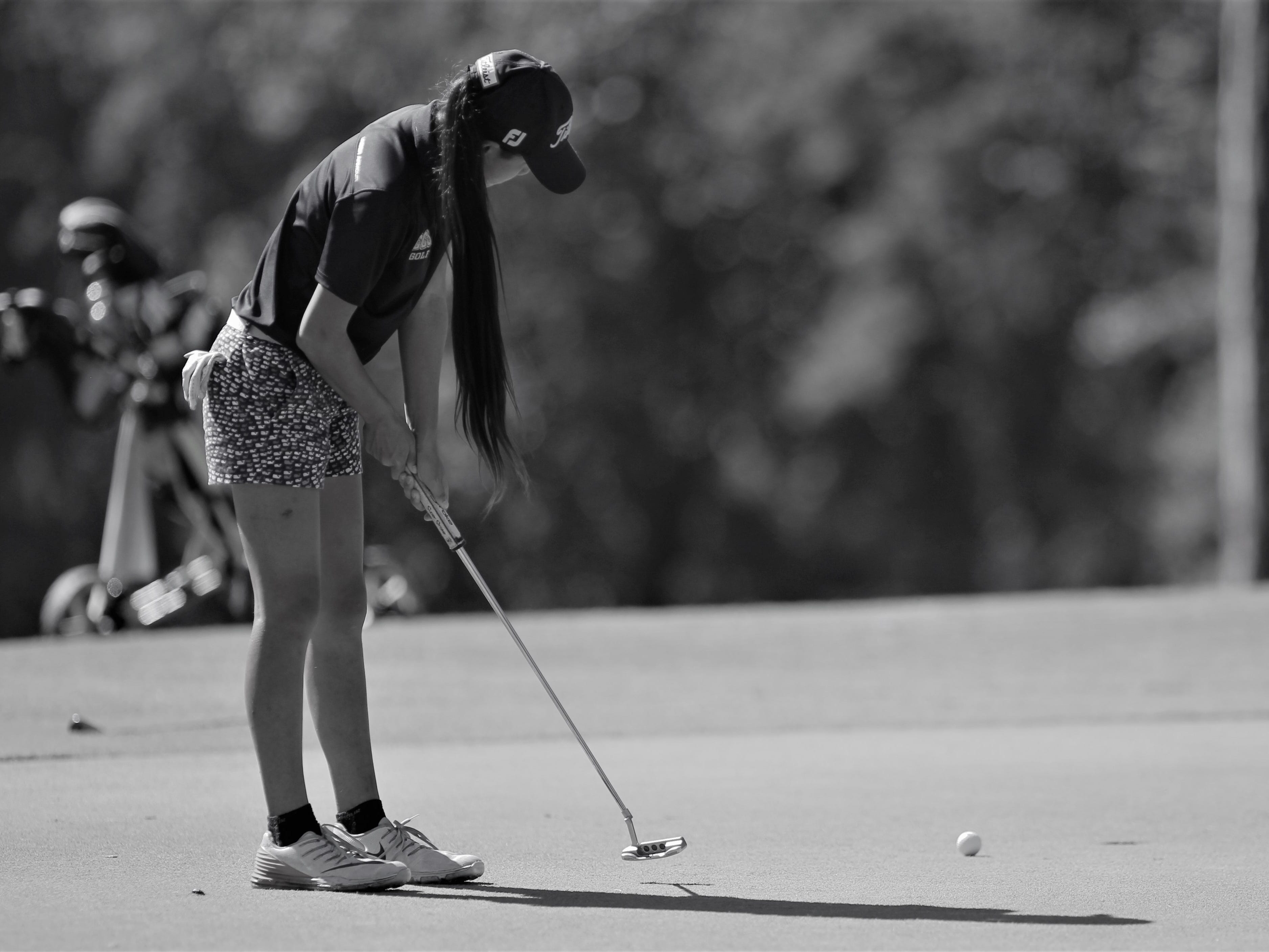 Community Christian eighth-grader Tynley Cotton putts during the girls golf Panhandle Invitational at Killearn Country Club, Oct. 4, 2018.