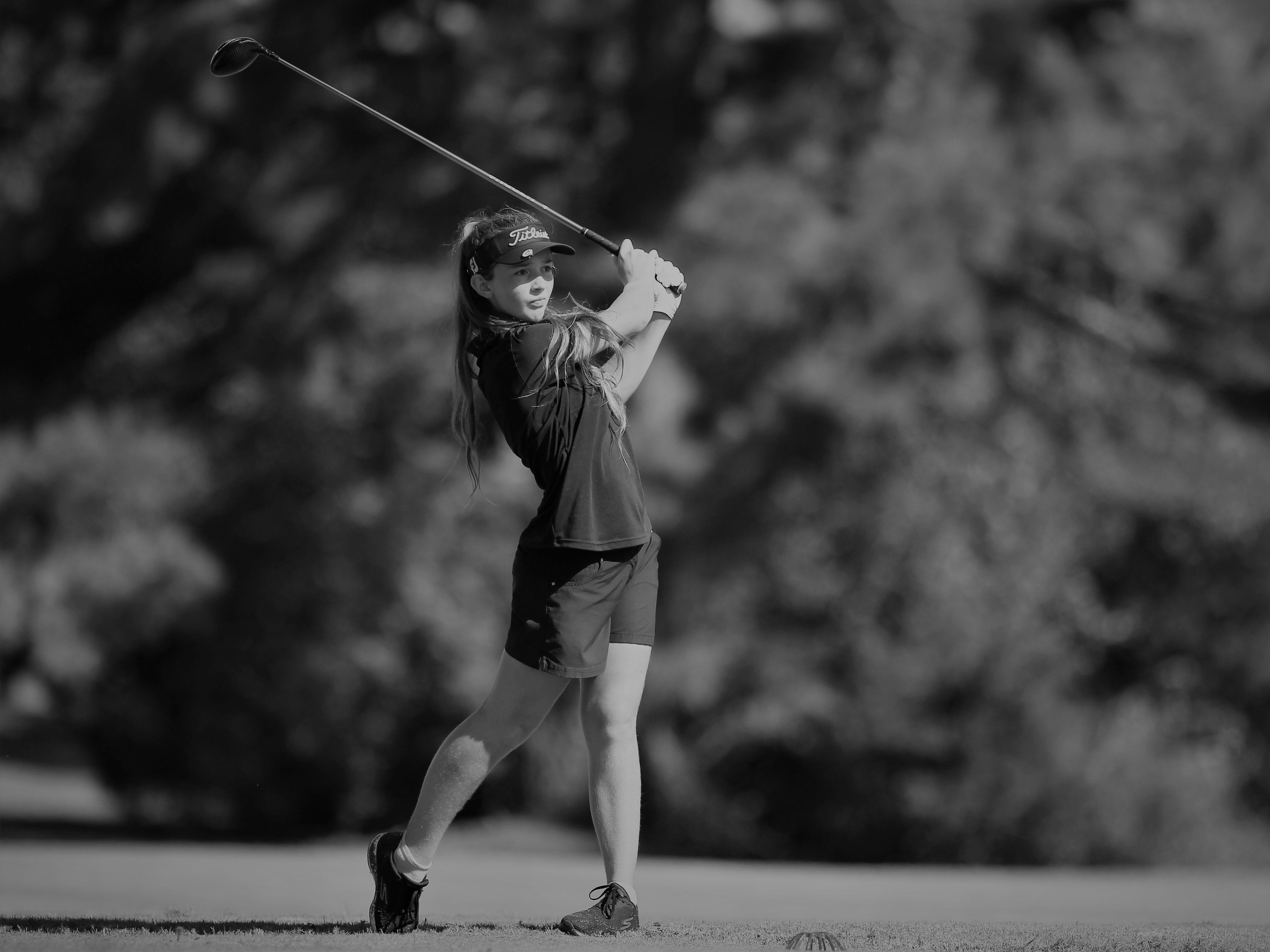 Community Christian eighth-grader Sabree Lefebvre watches a tee shot during the girls golf Panhandle Invitational at Killearn Country Club, Oct. 4, 2018.