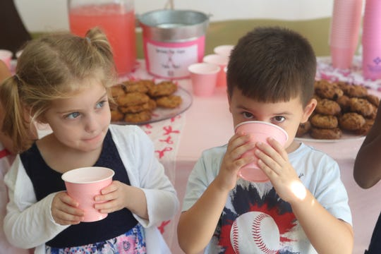 Children at the Growing Room day care center on Metropolitan Boulevard sold pink lemonade and cookies during the Tallahassee Go Pink event Thursday, Oct. 4, 2018.