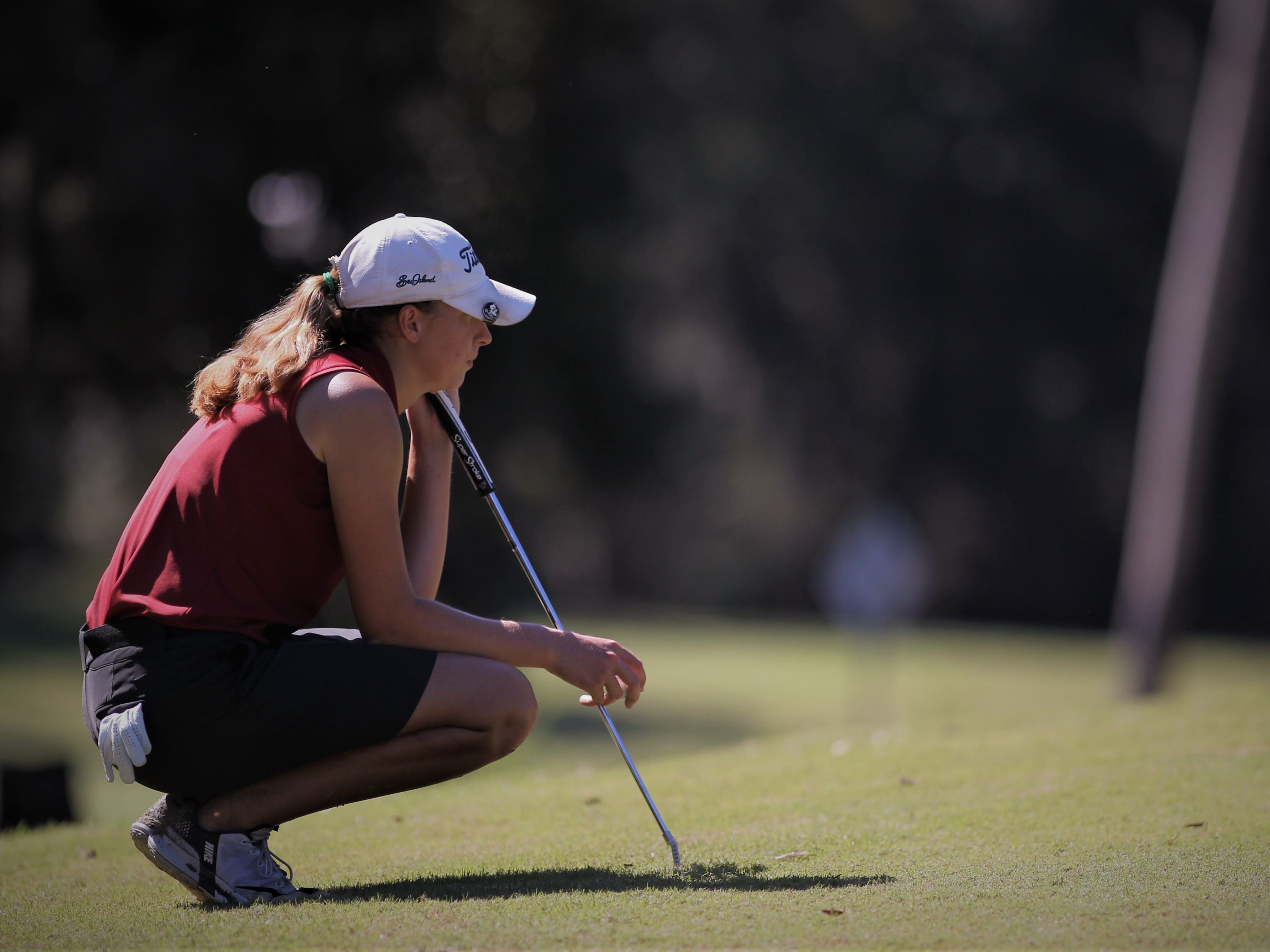 Chiles senior Mickela Helms waits to putt during the girls golf Panhandle Invitational at Killearn Country Club, Oct. 4, 2018.