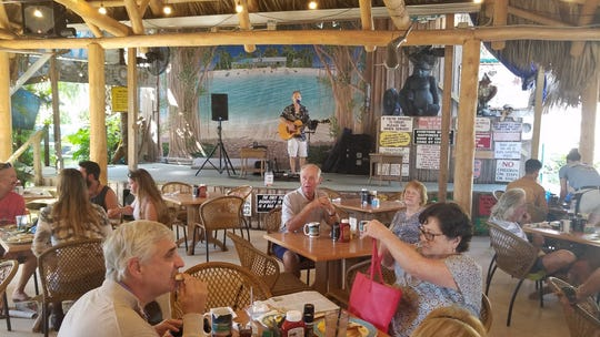 Dining and entertainment area at Harry and the Natives in Hobe Sound.