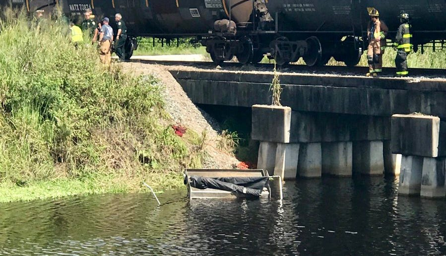 Crash with train puts dump truck into C-24 Canal; officials search for missing truck driver