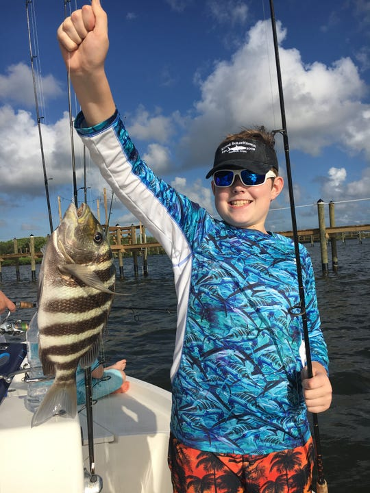 Brother Cameron caught a nice sheepshead while fishing the docks along the river.