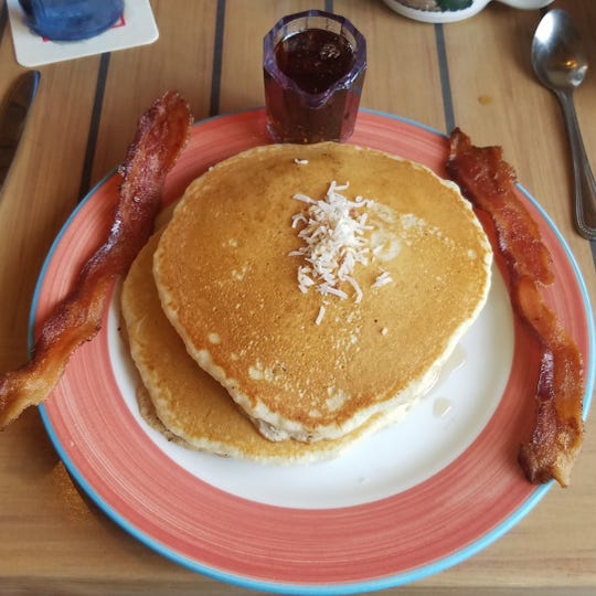 Harry and the Natives' coconut pancakes with a side of Applewood smoked bacon.