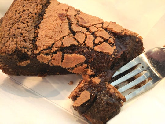 A slice of AKOHO (A Kitchen of Her Own) rich gluten-free chocolate cake.