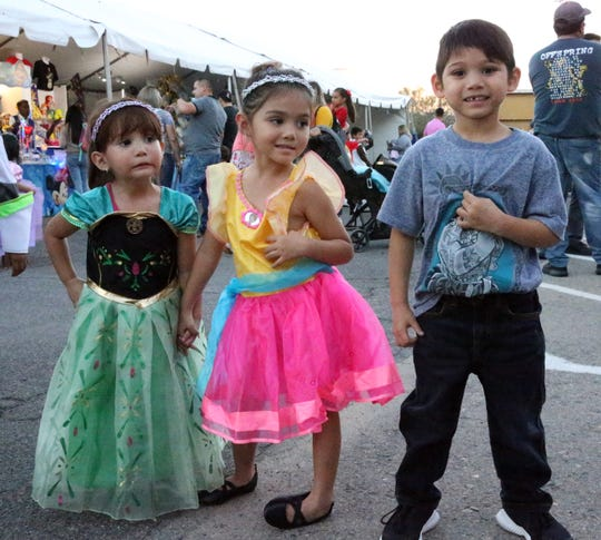 "Leilani Quidachay, left, and siblings Isabella Cortez and Dylan Cortez stand outside the El Paso County Coliseum for the Disney On Ice presentation ""Dare to Dream"" on Wednesday."