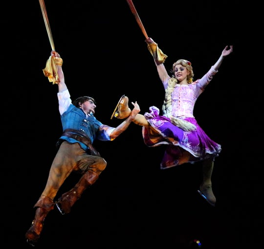 "Rapunzel and a prince spin in the air over the ice in this scene from the Disney On Ice presentation ""Dare to Dream"" during its opening night Wednesday at the El Paso County Coliseum. The production takes place through Sunday, with a Spanish show Thursday at 7:30 p.m. Friday's show is also at 7:30 p.m. and three shows will follow both Saturday and Sunday at noon, 3:30 and 7:30. Tickets are online at disneyonice.com or at the coliseum box office. This year's production will visit over 30 cities."