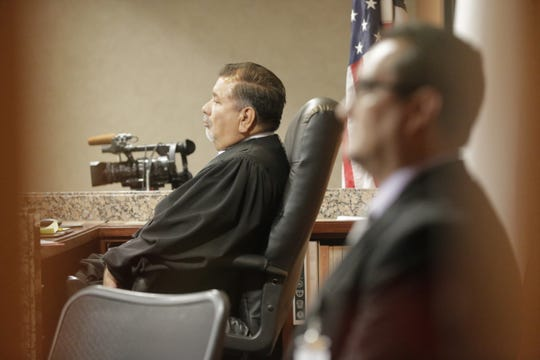 Judge Sam Medrano, left, listens Thursday during the trial of Daniel Villegas in the 409th District Court in El Paso.