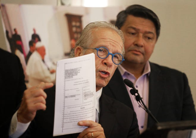 Attorney Jeff Anderson, left, with Manuel Vega, who says he was sexually abused by a priest over a five-year period decades ago, describes Vega's lawsuit against the Vatican, seeking the names of all offenders within the church worldwide, at a news conference Thursday in Los Angeles.