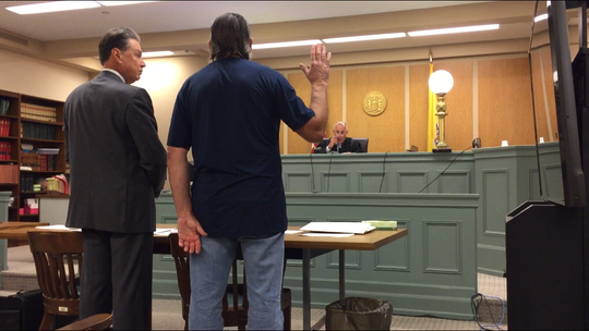 Vineland resident Richard A. Caulford is sworn in by Cumberland County Superior Court Judge Michael Silvanio on Thursday. Defense attorney Michael L. Testa Sr. (left) represents Caulford, charged with using dangerous fireworks that started a fire on July 4.