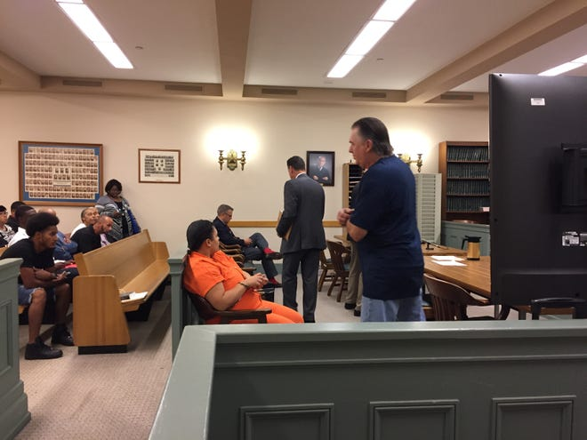Vineland resident Richard Caulford (center) was in Superior Court on Thursday for a hearing on charges his use of fireworks on July 4 set off a major fire. Defense attorney Michael L. Testa Sr. told the court his client was waiving his right to a grand jury hearing and seeking to enter a diversion program.