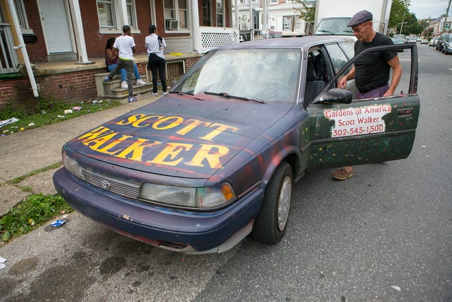 Republican U.S. House candidate Scott Walker rolls through Wilmington, putting up dozens of his homemade campaign signs.