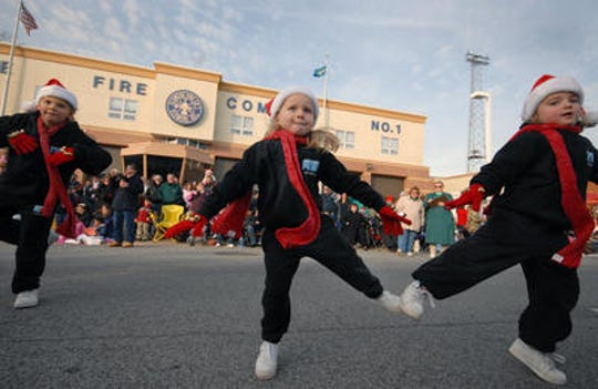A dance group struts their stuff in front of reviewing stand during the 2008 Elsmere Christmas Parade.