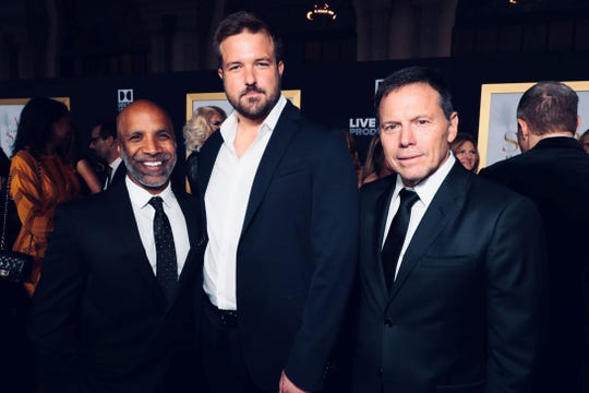 "Screenwriter Will Fetters (center) with Ravi Metha ""A Star Is Born"" executive producer (left) and ""A Star Is Born"" producer Bill Gerber at the film's Los Angeles premiere."
