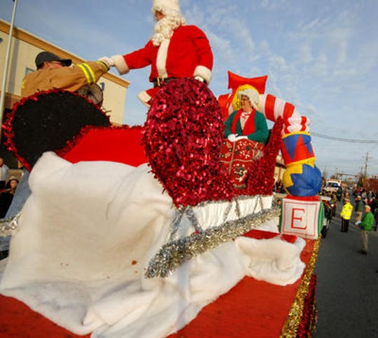Mr. and Mrs. Santa atop flaot in Elsmere parade in 2008.