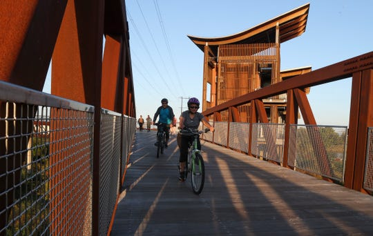 Bicyclists share the Jack A. Markell Trail with walkers where it passes the DuPont Environmental Education Center in Wilmington.